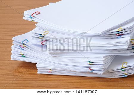 Pile Of Documents With Colourful Clips