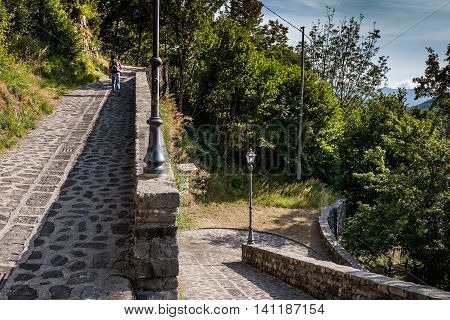 Garfagnana Tuscany Italy - Old Church of Gorfigliano Serchio Valley Lucca the path of the Cross leading to the church