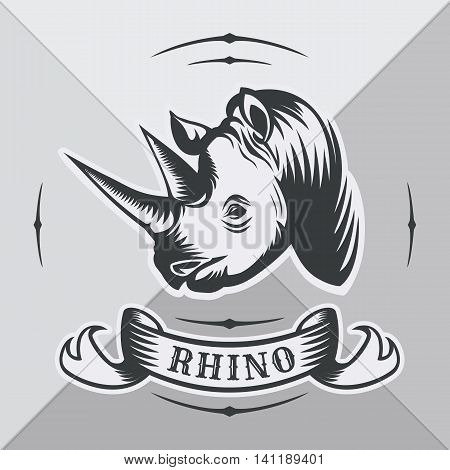 Head rhinoceros with vintage ribbon on gray background.