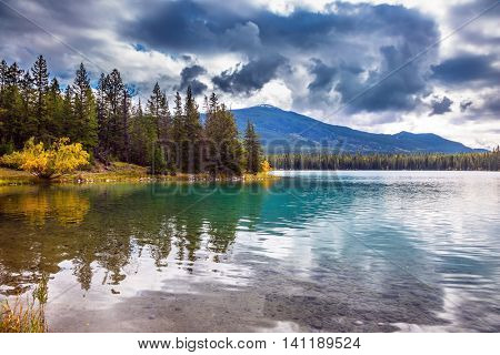 Canadian Rocky Mountains, Jasper National Park, lake Annette.  The picturesque oval lake with clear water