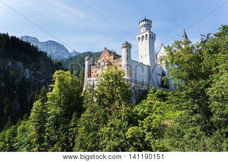 Castle Neuschwanstein in Germany. Summer in mountains