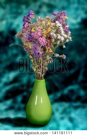 Bouquet Of Colorful Wild Flowers In A Vase On A Green Background