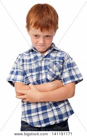 Offended angry little boy isolated on white background