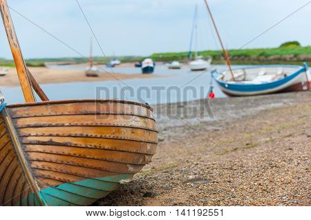 Sailing boast beached at Brancaster Staithe Norfolk