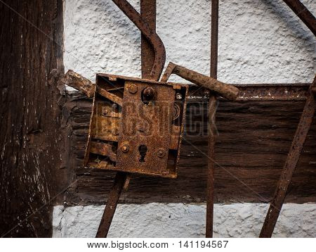 The old rusty lock on wall of farmhouse