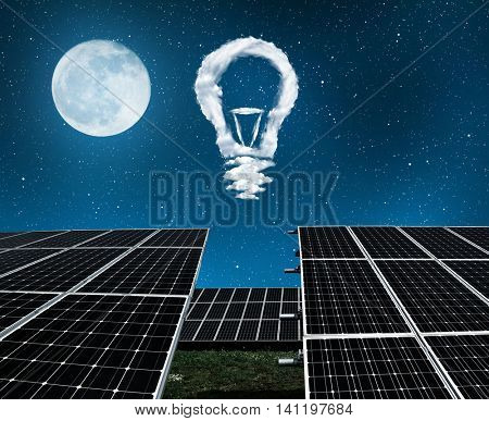 Solar panels with lightbulbs from clouds in night . The concept of sustainable resources.