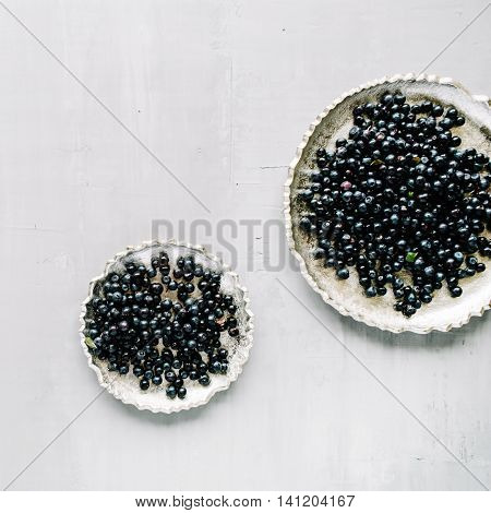 bilberry at golden retro tray on concrete background