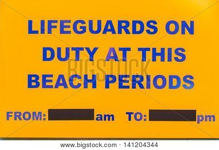 Beach lifeguard notice sign board public reading ocean swimming.
