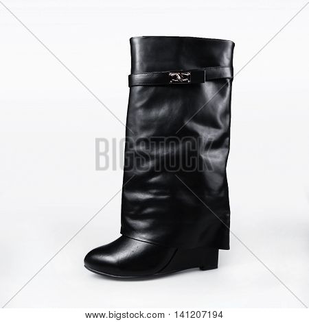 Female leather boot with high heel isolated on white