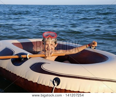 Smiling Little Girl With The Diving Mask On The Dinghy