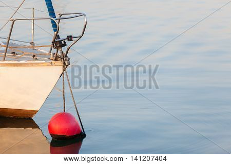 Yacht bow section anchored moored buoy  sea ocean water.