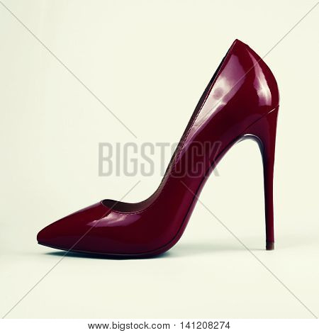 red female shoes in a white background