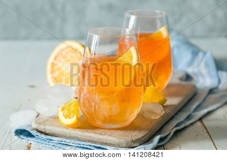 Spitz aperol cocktail in glasses, copy space