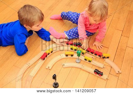 learning and daycare -kids playing with railroad and trains indoor,