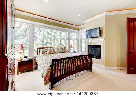 Amazing Bedroom Interior With Fireplace And Cherrywood Furniture Set.