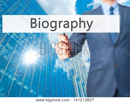 Biography - Businessman Hand Holding Sign