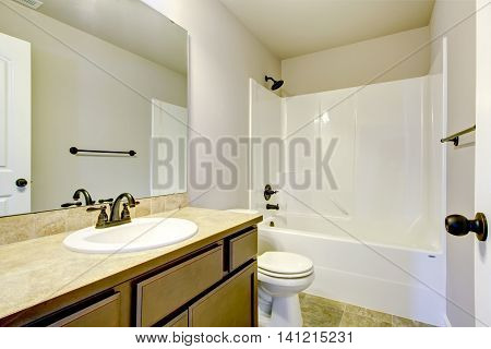 View Of Light Tones Bathroom With Modern Vanity Cabinet.