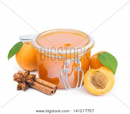 Apricot jam with cinnamon and fresh fruits isolated on white background