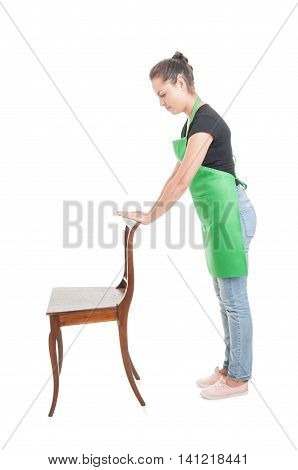 Side View Of Young Employee Holding Wooden Chair