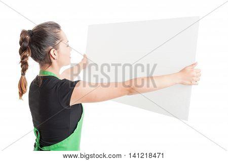 Young Saleswoman Holding Big Empty Billboard