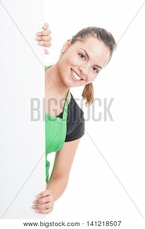 Attractive Female Employee Standing Behind Blank Banner