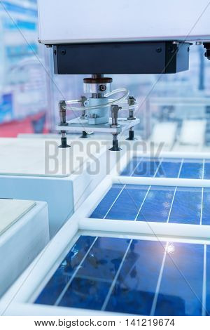 production of solar panels, Industrial robot working in factory,Conveyor Tracking Controller of robotic hand.