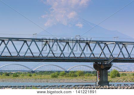 Train Bridge And Mount Fuji Background.