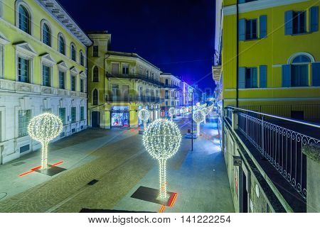 Night view of Collegiata square with Christmas decorations and the Viale Stazionne street in Bellinzona Ticino Switzerland