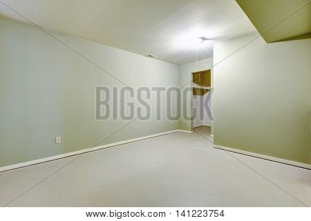 Empty Basement Room In Ivory Color With Pantry.