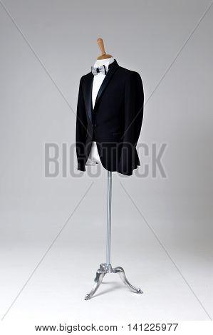 Modern Black Tuxedo Isolated On Grey Background