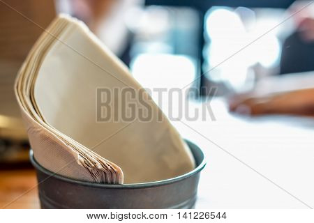 brown tissue paper in the basket with bokeh background