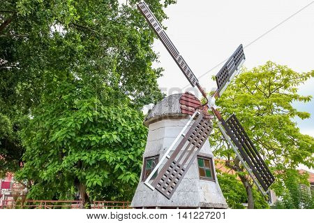 MALACCA MALAYSIA - JULY 16 2016: Windmill in the Jonker Street is the centre street of Chinatown in Malacca. It was listed as a UNESCO World Heritage Site on 7 July 2008.