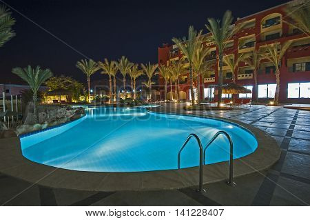 Swimming Pool In Luxury Tropical Hotel Resort At Night