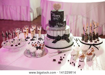 Stylish sweet candy bar set at the wedding ceremony confectionery
