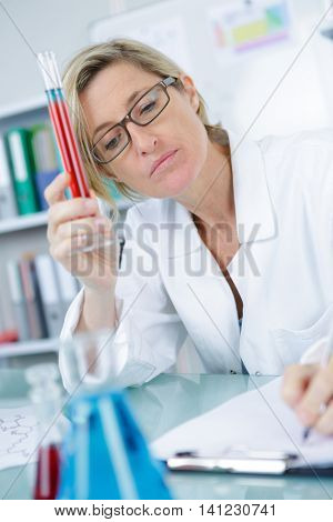 female technician with pipetting pcr strope