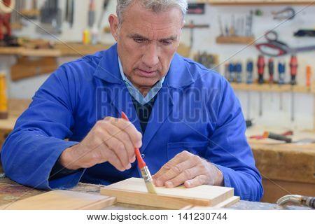 senior man working on his work bench