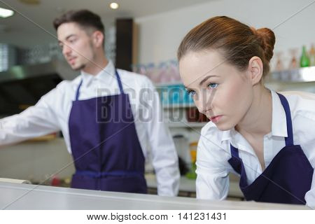 waitress and waiter working in cafe