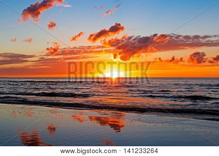 Beautiful Sunset Over Baltic Sea with cloud and beams, Jurmala Dzintari.