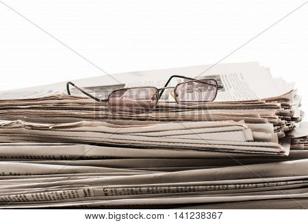 newspaper with glasses publication media communication closeup