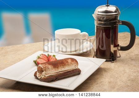 A beautiful presentation and setting the tiramisu and coffee