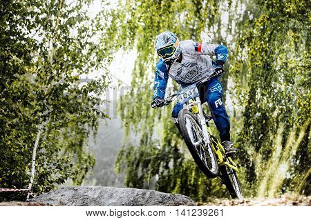 Magnitogorsk Russia - July 23 2016: jump on bike man extreme racer during National championship downhill