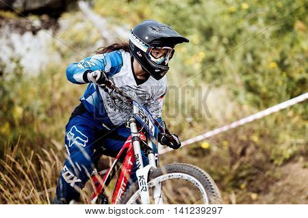Magnitogorsk Russia - July 23 2016: closeup of female extreme racer bike during National championship downhill