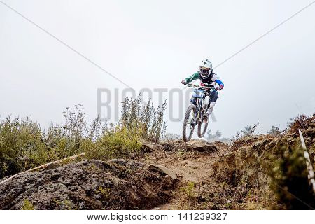 Magnitogorsk Russia - July 23 2016: man extreme athlete on bike jump on top of mountain during National championship downhill
