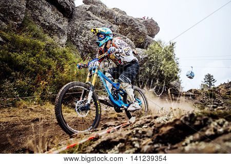 Magnitogorsk Russia - July 23 2016: down on a mountain trail extreme athlete bike during National championship downhill