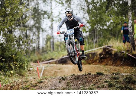 Magnitogorsk Russia - July 23 2016: jump over hill male extreme athlete bike during National championship downhill