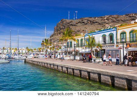 PUERTO DE MOGAN, GRAN CANARIA, SPAIN - APRIL 21, 2016: Marina of Puerto de Mogan, a small fishing port on Gran Canaria, Spain. Puerto de Mogan is called a Little Venice of the Canaries.