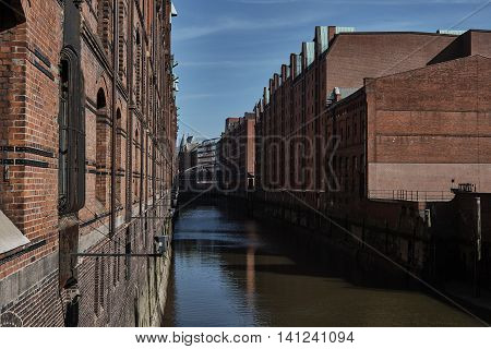 View into a waterway of the old Speicherstadt of Hamburg