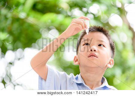 Boy Using Eyedroper