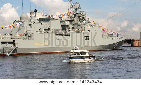 St. Petersburg, Russia - 31 July, Police boat at the warship, 31 July, 2016. Festive parade of warships on the Neva River in St. Petersburg.