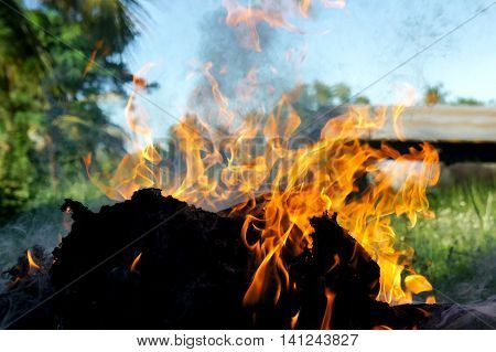 Lighta fire ,in the outside area. May create a hazard to those nearby. be careful